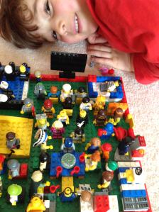 Child with Lego Mini Figures.